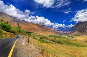 picture of jammu kashmir  - Road and Rocky mountains with blue sky with clouds in background of Leh Ladakh Jammu and Kashmir India - JPG