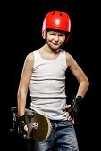 image of attitude boy  - Boy with red hair with skateboard and helmet on a black background - JPG