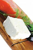 foto of redfish  - single pink salmon bit on a big wooden dish with white cheese - JPG