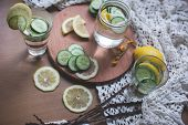 stock photo of infusion  - infused fresh and tasty lemon cucumber water - JPG