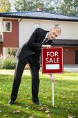 picture of house representatives  - Young estate agent is preparing house for sale - JPG