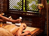 pic of ayurveda  - Woman having Ayurveda massage with herbal ball - JPG