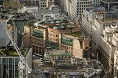 stock photo of posh  - View from a tall building of the James Stirling designed office block Number One Poultry.  In the heart of the City of London it is home to Aviva Investors and a posh restaurant.