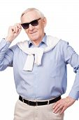 picture of toothless smile  - Stylish senior man adjusting his glasses and smiling while standing against white background - JPG