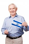 picture of israel people  - Cheerful senior man holding flag of Israel and smiling at camera while standing against white background - JPG