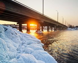 stock photo of rayon  - Snowy bridge and beautiful frosty sunset on the river in winter in Ukraine - JPG