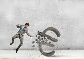 image of karate  - Businessman breaking stone euro symbol with karate punch - JPG