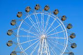 image of ferris-wheel  - Ferris Wheel Isolated on the Blue Sky Background - JPG
