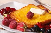 pic of french-toast  - The sweet French toast with syrup and fresh berries close - JPG