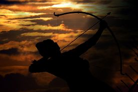 stock photo of mahabharata  - An ancient mythological archer or Arjun one of the pandavas from hindu scripture or mythology - Mahabharata on the sunset sky. ** Note: Visible grain at 100%, best at smaller sizes - JPG
