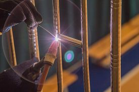 picture of tig  - Welder TIG welds fences made of polished stainless steel - JPG