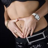 picture of pierced belly button  - Midriff of a young woman showing pierced belly button and jewelery - JPG