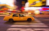 Taxi Cab Speeding Through New York City, With Motion Blur