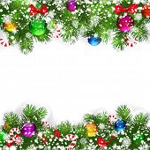 Christmas background with decorated branches of Christmas tree.