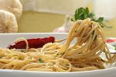 stock photo of italian food  - Plate of spaghetti with tomato sauce and a fork - JPG