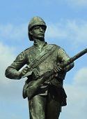 Military Memorial. Bronze soldier, blue sky.