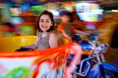 Little girl having fun in a carousel