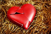 stock photo of broken-heart  - Photo with a broken heart protected with straws - JPG