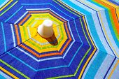 Close-up detail of a colorful sunshade under hard sun-light.