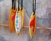 closeup of little wooden surfboard trinkets hanging in a store