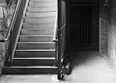 City Cellar Stairs leading down to stone and brick lower level in black and white