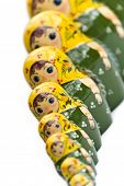 Russian dolls in a line isolated on white