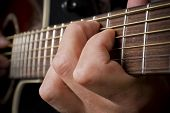 stock photo of acoustic guitar  - Musician playing acoustic guitar - JPG