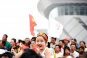 Inner Mongolia,China - JULY 10:  A cute girl among celebrating crowd during the olympic torch relay