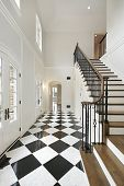 Foyer in luxury home with checkerboard floor
