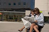 Businesswoman Looking At A Newspaper