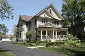 Luxury home in suburbs with front porch