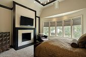image of master bedroom  - Master bedroom with fireplace and wall of windows - JPG