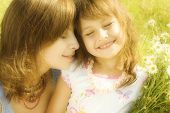 pic of mother child  - Mother resting outdoor with daughter - JPG