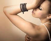 stock photo of beautiful young woman  - beautiful young woman with pearls - JPG