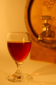 stock photo of tokay wine  - A glass of port with barrel background - JPG