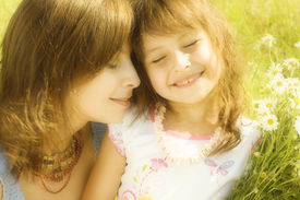 stock photo of mother child  - Mother resting outdoor with daughter - JPG