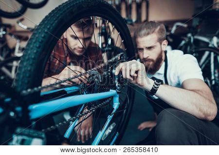 Guy And Bike Mechanic Repairs