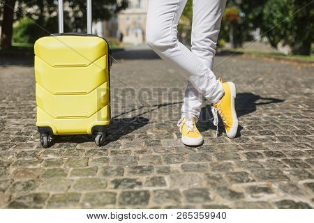 poster of Cropped Image Traveler Tourist Woman Crossed Legs In Yellow Summer Casual Clothes With Suitcase On R