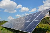 Solar Panels With Beautiful Clouds Sky In The Garden.  Backyard Solar Panels For Energy Efficiency. poster