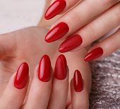 Bright Festive Red Manicure On Female Hands. Nails Design poster