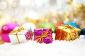 Colorful Christmas Gifts In Snow