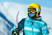 Extreme Holidays. Horizontal Cropped Shot Of A Snowboarder In Blue Jacket And Yellow Helmet Wearing  poster