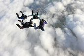 Four skydivers in freefall