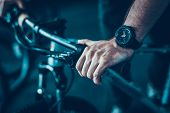 Closeup Of Male Hand Holds Cycle Handlebar. Mans Muscular Hand Wearing Modern Black Stylish Hand Wat poster