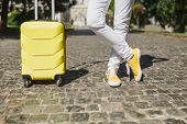 Cropped Image Traveler Tourist Woman Crossed Legs In Yellow Summer Casual Clothes With Suitcase On R poster