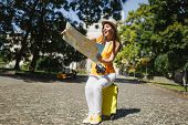 Amazed Traveler Tourist Woman In Yellow Clothes Hat Sitting On Suitcase Looking On City Map Search R poster