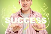 Man with word sucess over his hands. Concept of successful people and positive thinking.