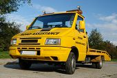 stock photo of tow-truck  - Shot of yellow road assistance vehicle parked - JPG