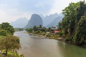 Scenic View Of The Nam Song River, Pha Tang Village And Limestone Mountains Near Vang Vieng, Vientia poster