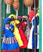 Market stall in Havana selling traditional cuban rag dolls and musical instruments